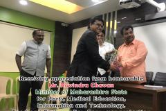 Receiving appreciation from Mr. Ravindra Chavan, Hon. Minister of Maharastra State